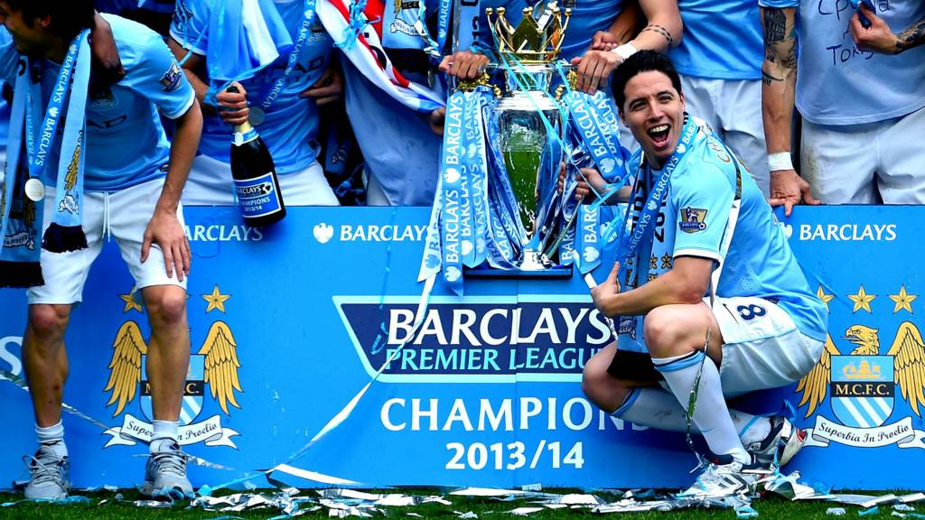 Samir Nasri and the team pose with the trophy