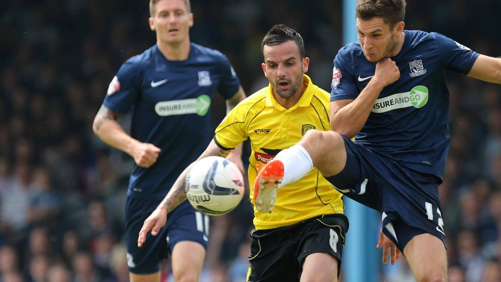 """Southend United""""s Will Atkinson takes the ball away from Burton Albion""""s Robbie Weir"""