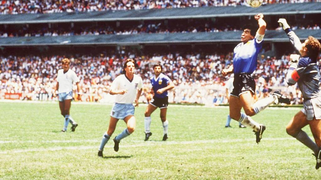 Diego Maradona's hand of god goal is watched by the England defence
