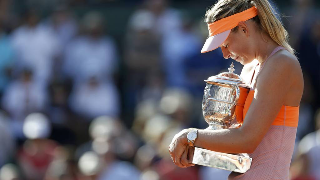 Maria Sharapova of Russia holds the trophy