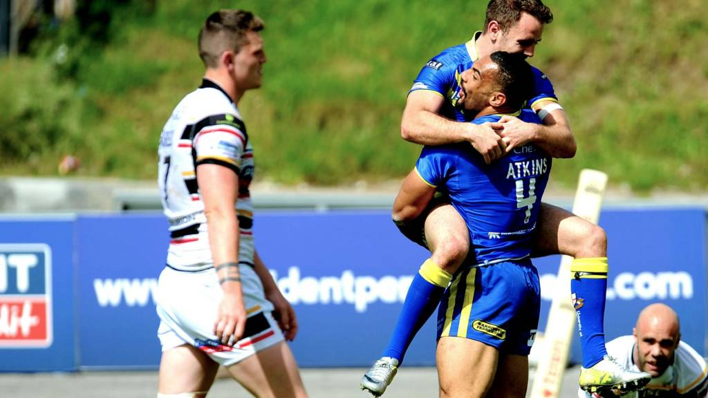 Warrington Wolves' Ryan Atkins celebrates with Richie Myler