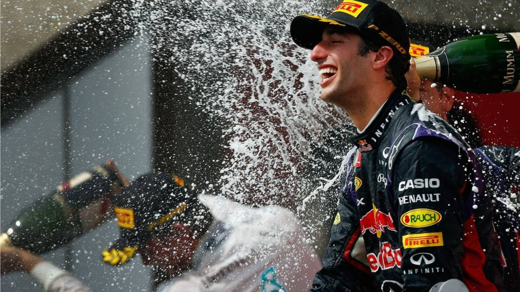 Racewinner Daniel Ricciardo of Australia and Infiniti Red Bull Racing is sprayed with champagne by teammate Sebastian Vettel of Germany
