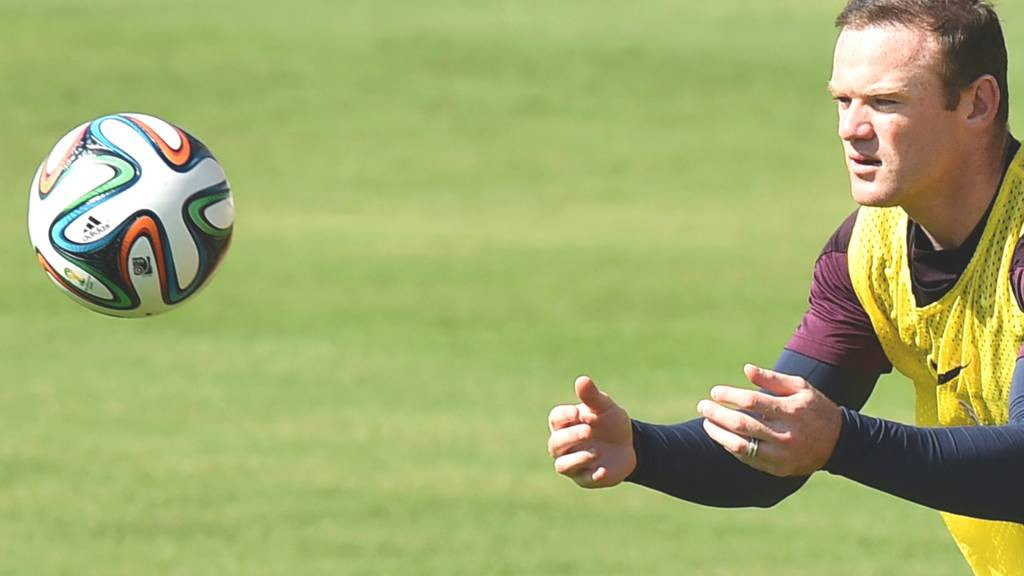 Wayne Rooney catches the ball in England training ahead of his side's game against Italy in the 2014 Fifa World Cup