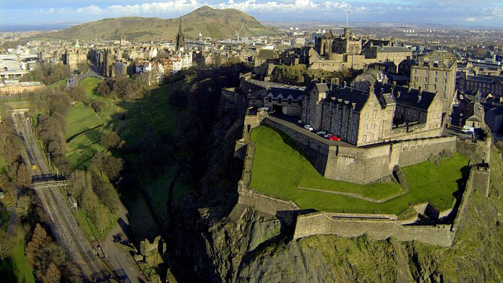 Edinburgh Castle with Arthur's Seat in background.