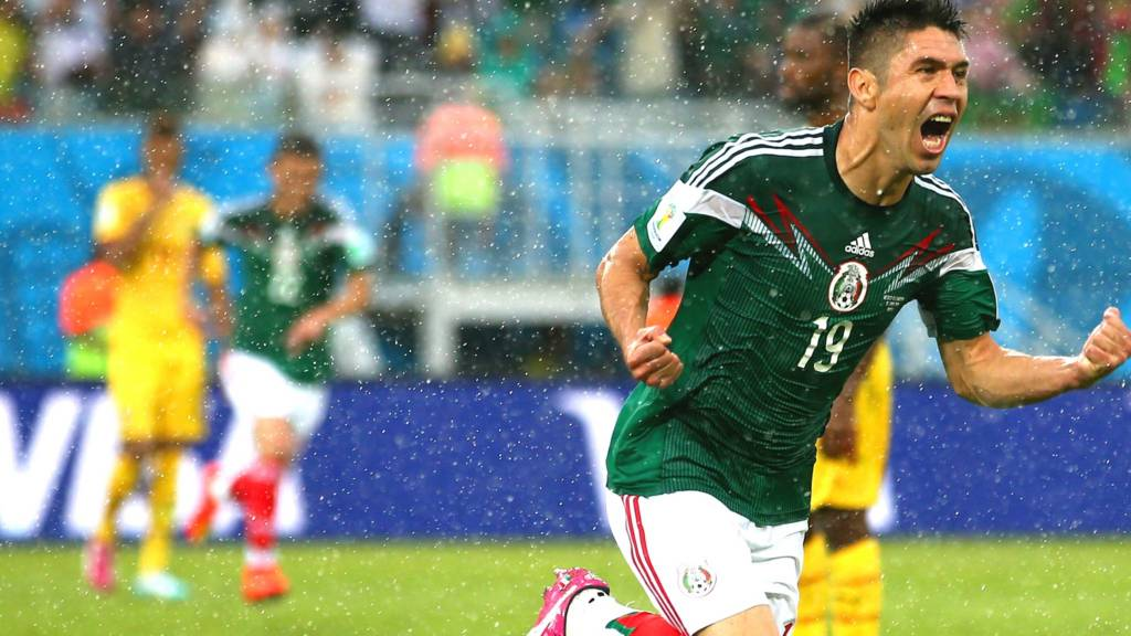 Oribe Peralta celebrates after scoring Mexico's first goal