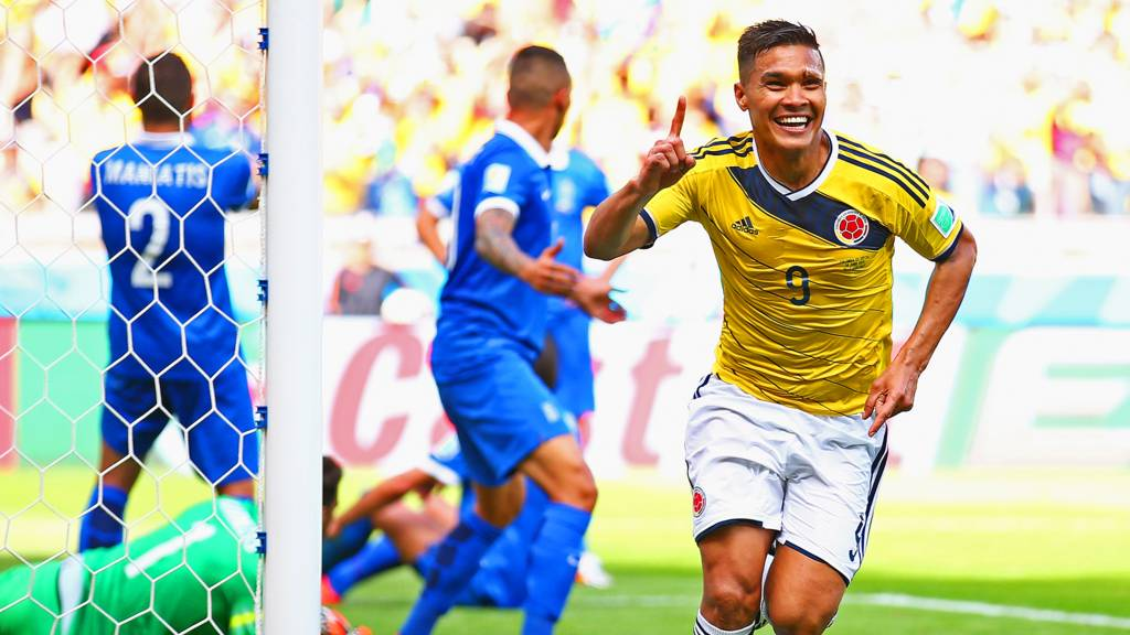 Teofilo Gutierrez celebrates after scoring Colombia's second goal against Greece