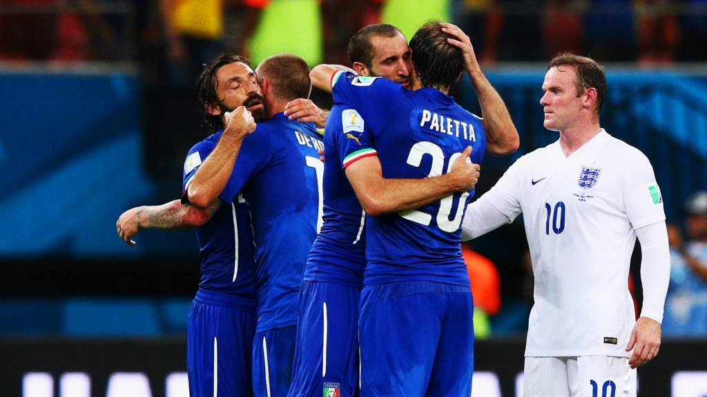 Wayne Rooney looks on as Italy celebrate their 2-1 win over England