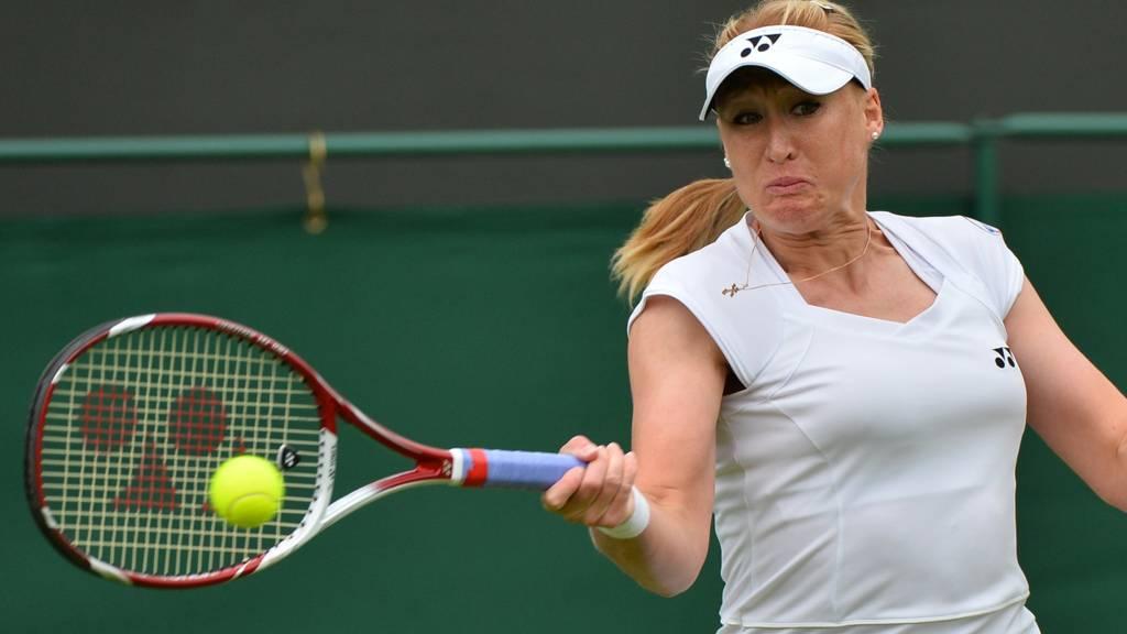 Britain's Elena Baltacha returns against Italy's Flavia Pennetta