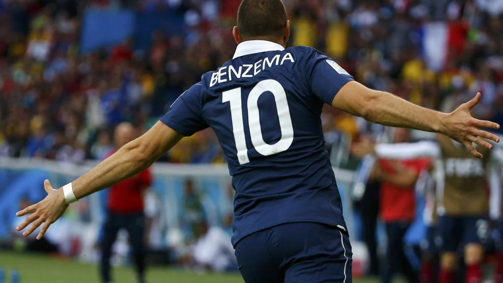 Karim Benzema celebrates after scoring France's third goal of the evening
