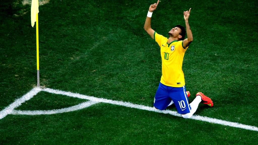 Neymar celebrates scoring for Brazil in their World Cup opener against Croatia