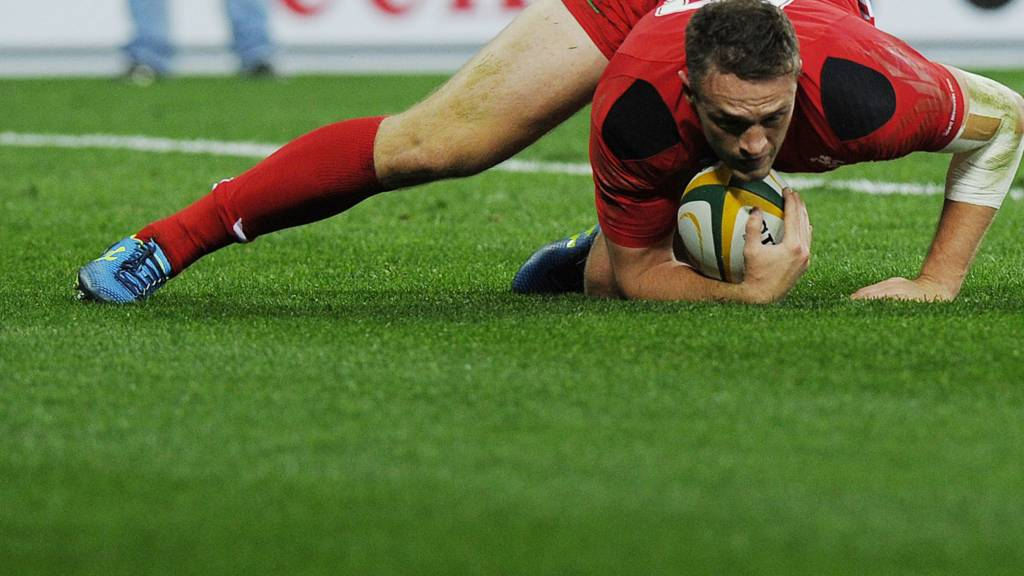 Corey Allen of Wales scores a try