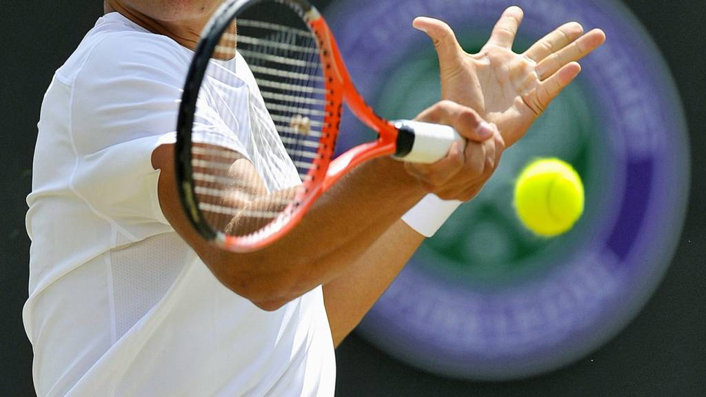 A tennis player in action at Wimbledon