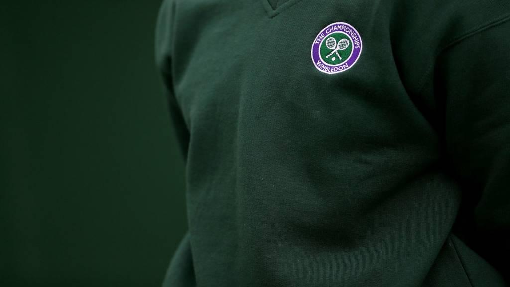 A ball boy stands alert at Wimbledon