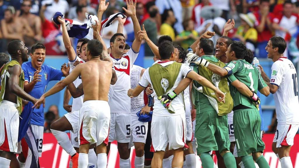 Costa Rican players celebrate after the group D World Cup win over Italy