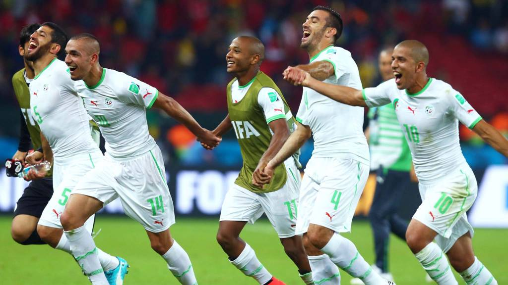 Algerian players celebrate at full time
