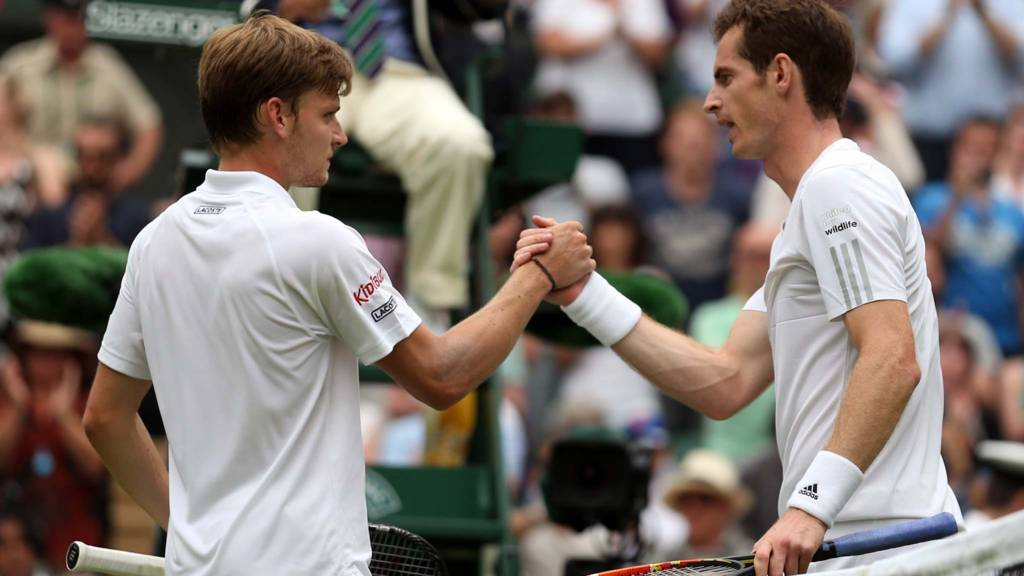 Andy Murray of Great Britain shakes hands at the net with David Goffin of Belgium following their match