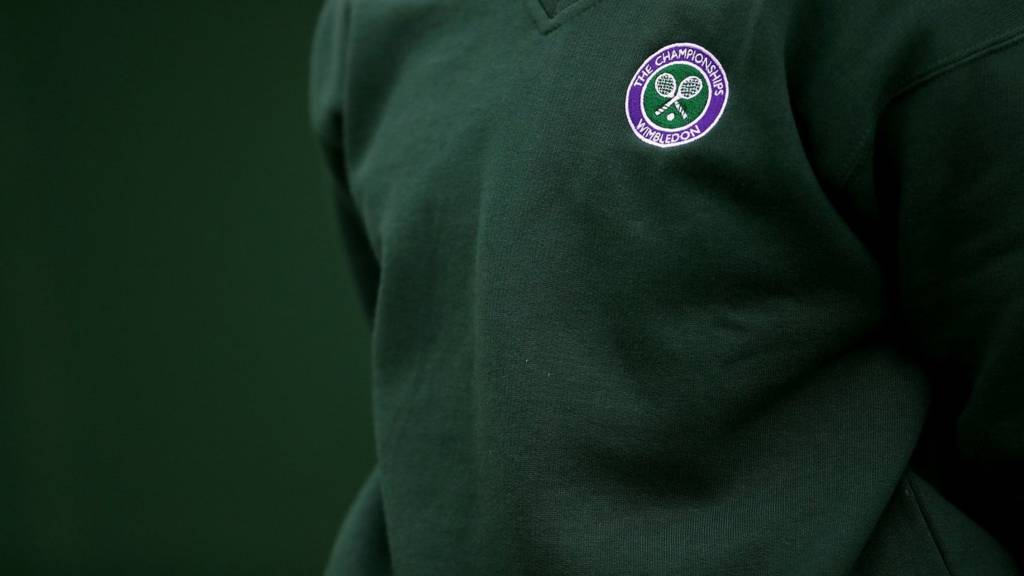 A ball boy stands alert at Wimbledon