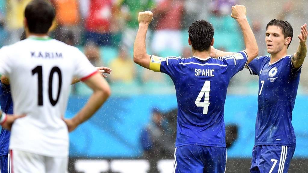 Bosnia-Herzegovina's defender Emir Spahic and Bosnia-Herzegovina's midfielder Muhamed Besic celebrate