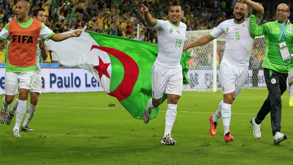 Algeria players celebrate after reaching the last 16 of the 2014 Fifa World Cup