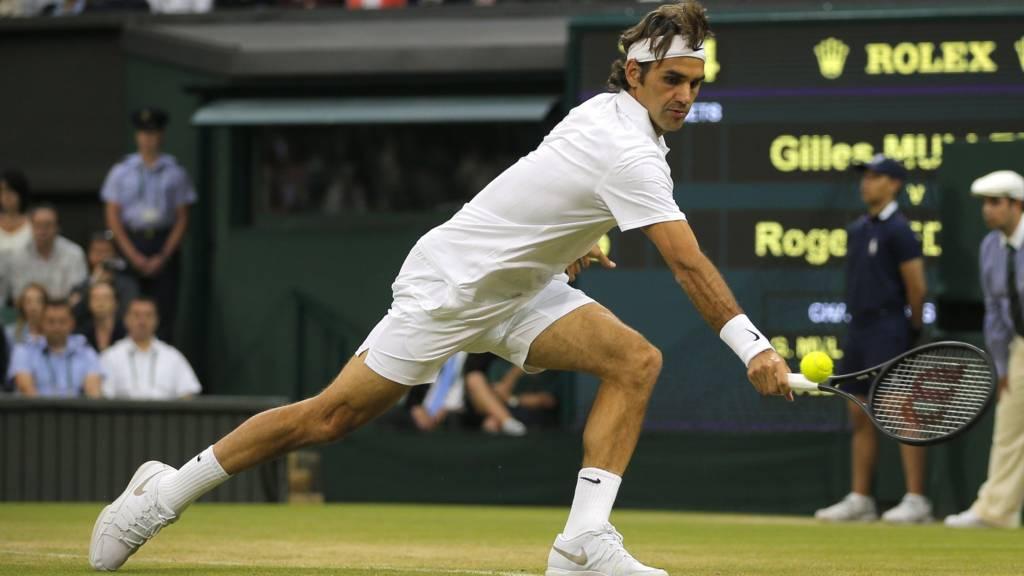 Roger Federer of Switzerland plays a return