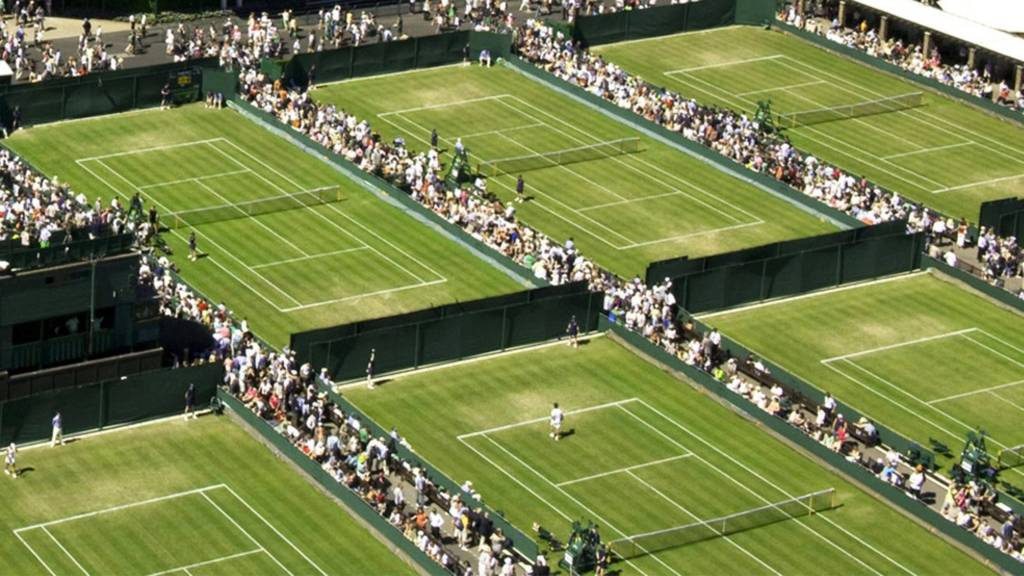 Tennis matches being played at the Wimbledon Championships