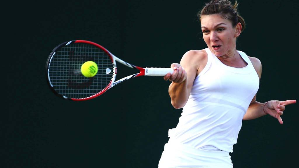 Simona Halep of Romania hits a forehand return
