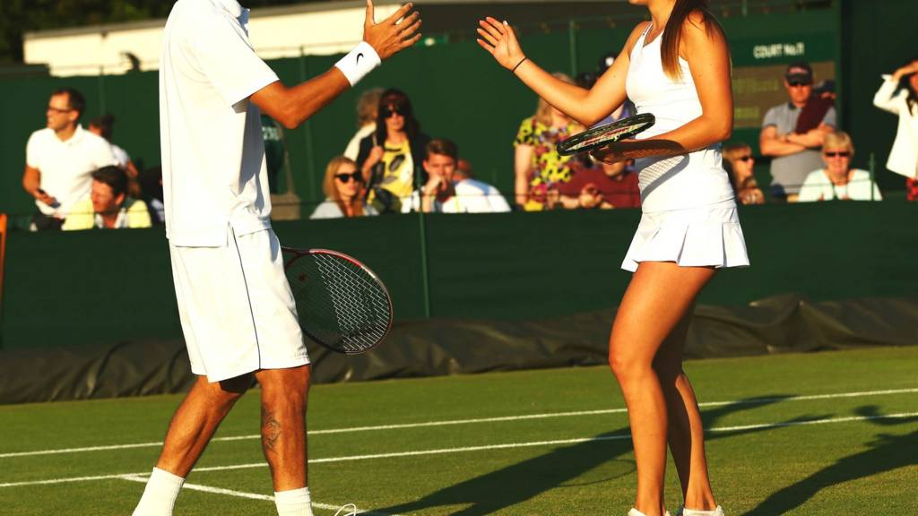 Mixed doubles partners in action at Wimbledon 2014