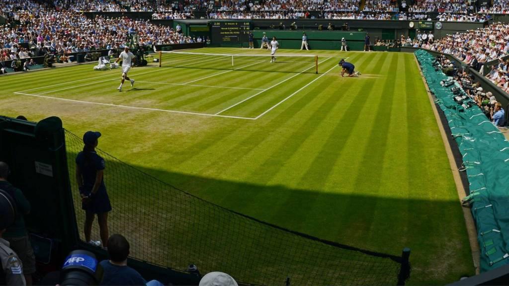 A tennis match being played on Centre Court at Wimbledon