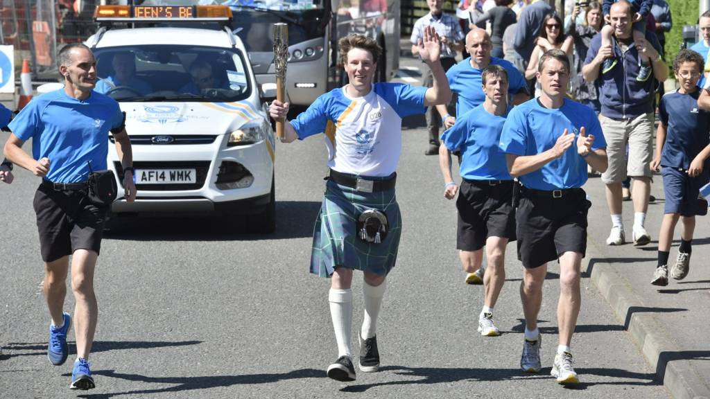 Calum MacIntyre with the baton