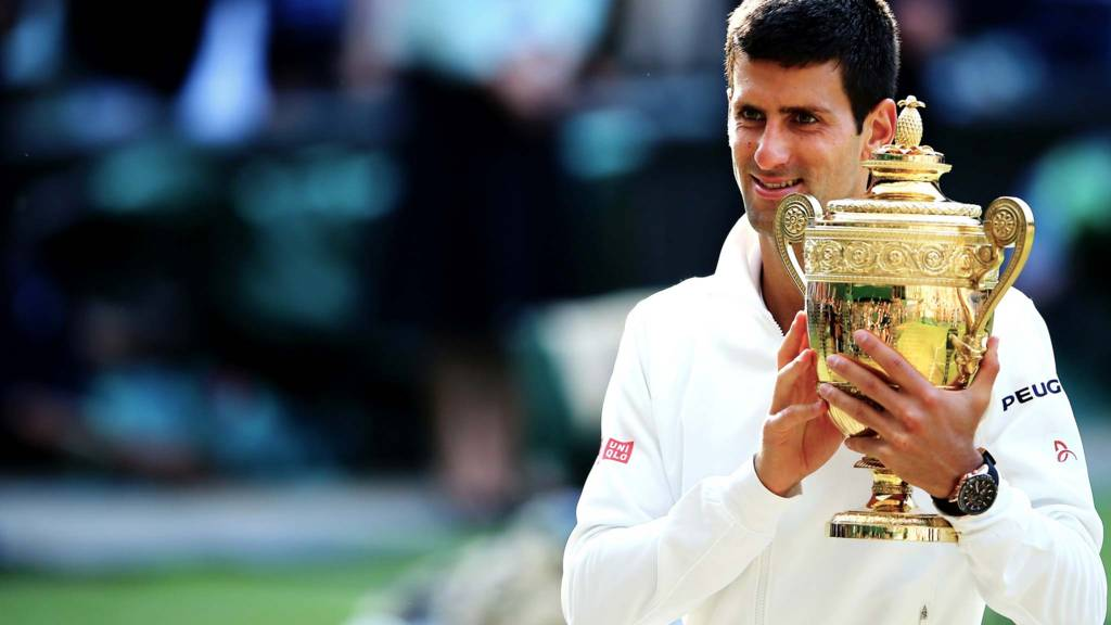 Novak Djokovic of Serbia poses with the Gentlemen's Singles Trophy