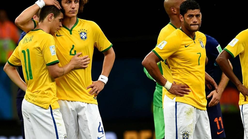 Hulk and David Luiz after Brazil lose to Netherlands