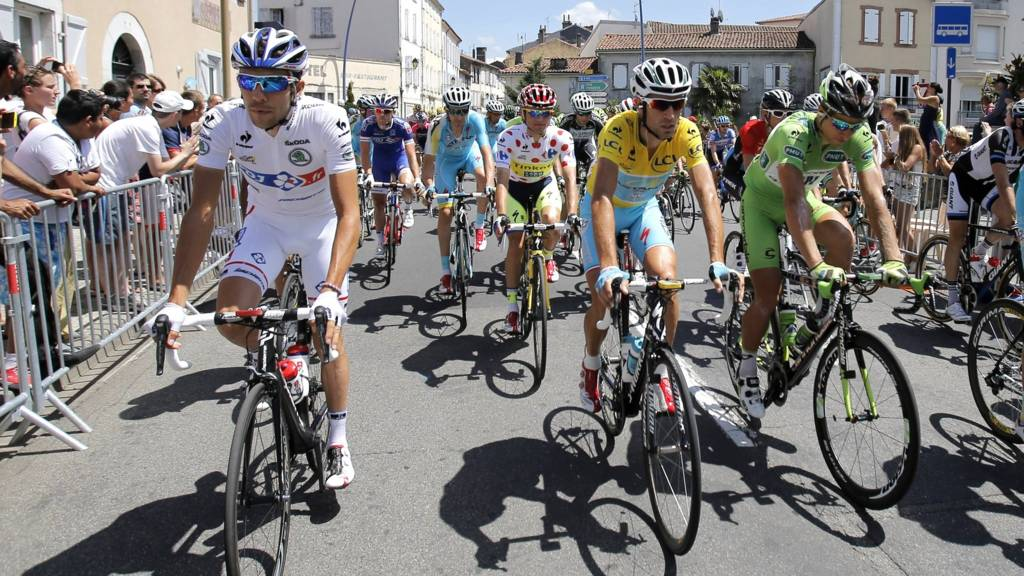 Riders ride on the streets during the 17th stage