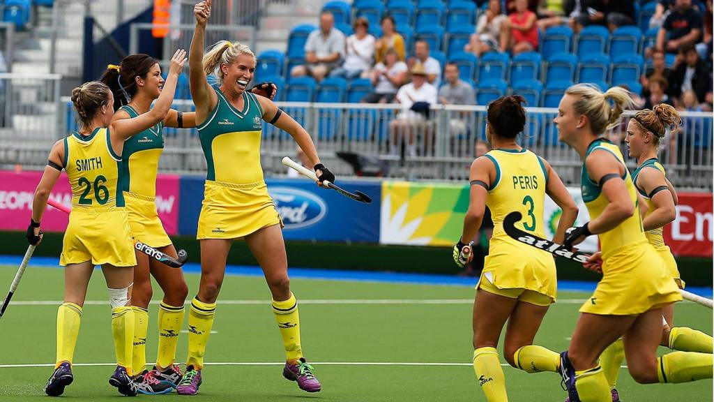 Australia's Jodie Kenny celebrates after scoring against Malaysia