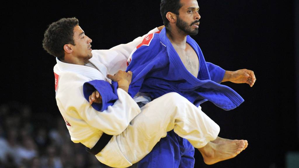 McKenzine of England battles in judo at Glasgow 2014 Commonwealth games