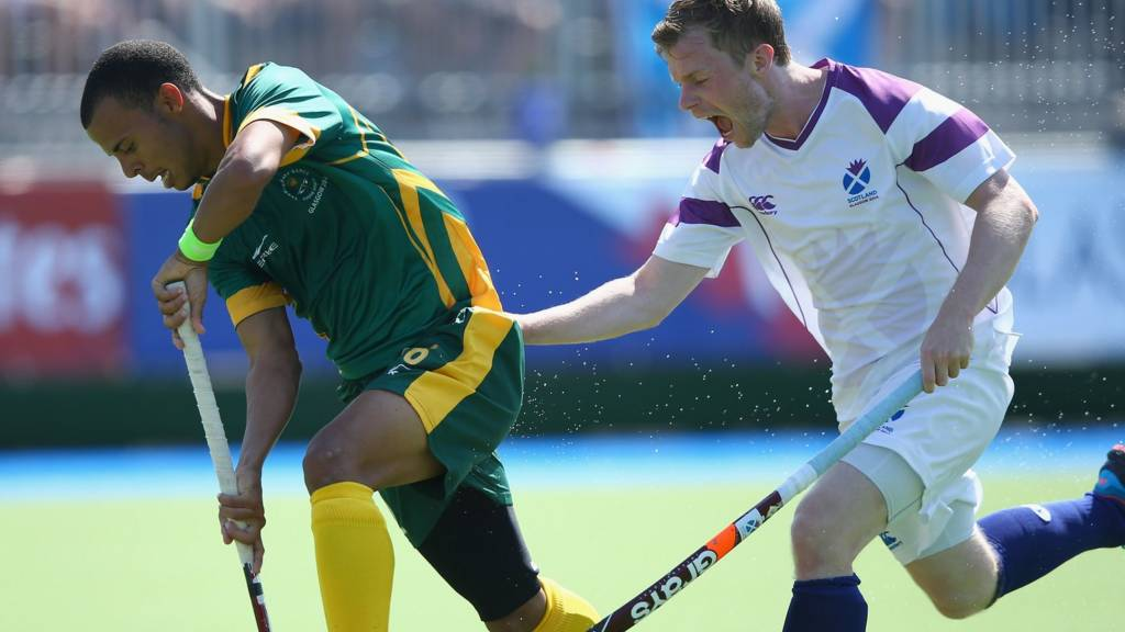 Michael Bremner of Scotland tries to tackle a South African player on the second day of the 2014 Commonwealth Games
