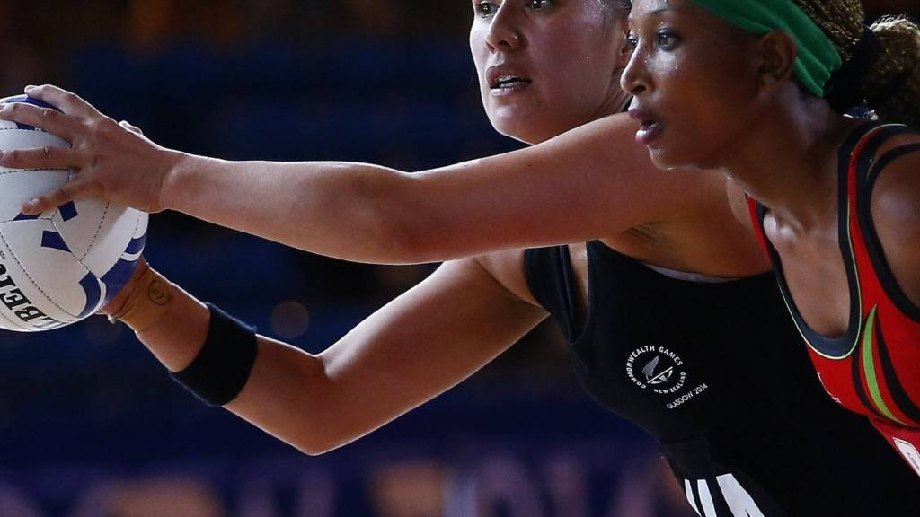Tina Kamzati of Malawi pressures the New Zealand defender at Glasgow 2014