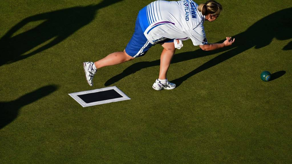 Caroline Brown of Scotland competes in the lawn bowls