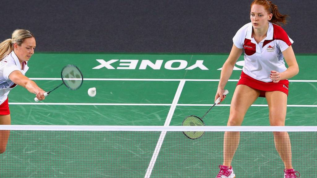 Gabby Adcock and Lauren Smith of England play a shot during their Mixed Team Group Play match