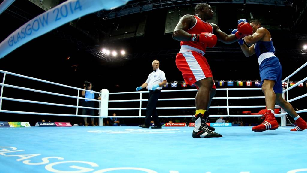 Joseph Joyce of England (blue) in action against Keddy Agnes of Seychelles