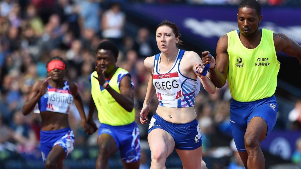 "Scotland's Libby Clegg runs with her guide runner in the women""s 100m T12 at Hampden Park"