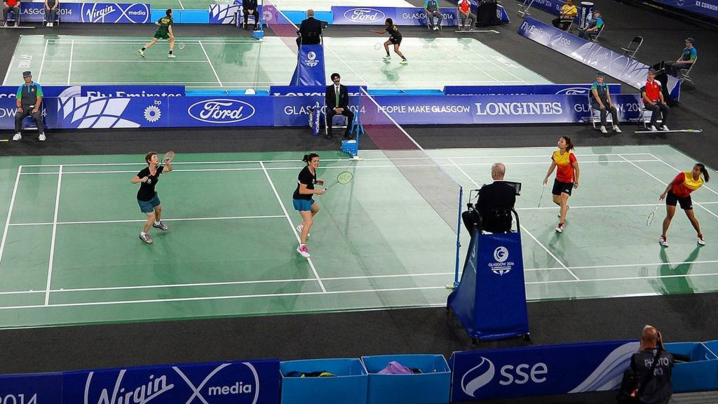 A general shot of the Emirates Arena as several badminton matches are played