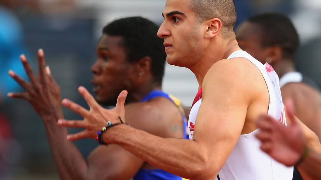 Adam Gemili of England makes it through to the 100m final