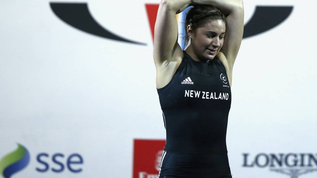 Bailey Rodgers of New Zealand reacts to her 75kg lift
