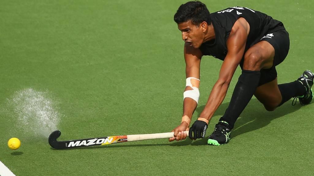 Arun Panchia of New Zealand strikes the ball