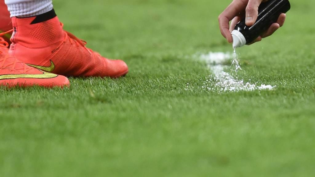 A referee sprays vanishing spray