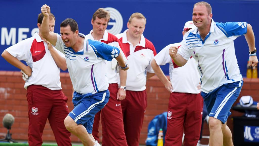 Scotland's men's fours team celebrate