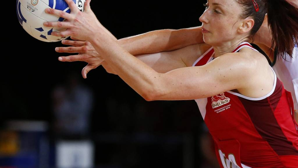 Jade Clarke of England challenges for the ball