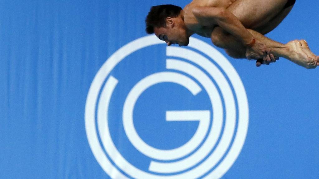 Tom Daley of England competes in Glasgow
