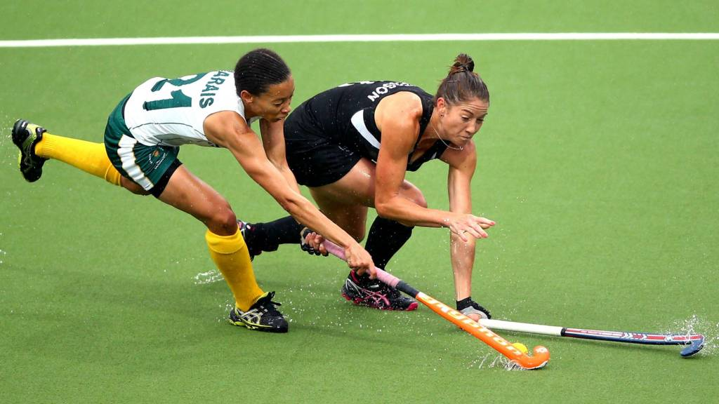 Lenise Marais of South Africa tackles Krystal Forgesson of New Zealand in the Women's Bronze Medal Match