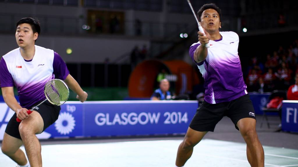 Danny Chrisnanta and Chayut Triyachart of Singapore contest the badminton at Glasgow 2014